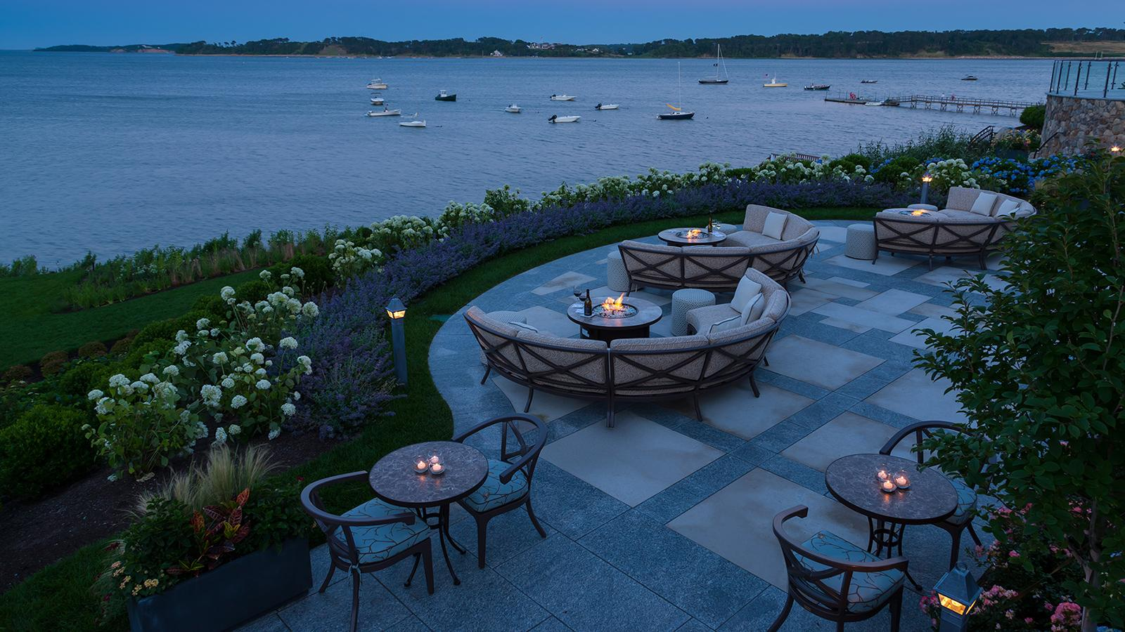 The Wequassett Resort and Golf Club in Harwich, Massachusetts, has a cigar-friendly area of semi-circular couches around firepits, angled for a view of the tranquil waters of Pleasant Bay.