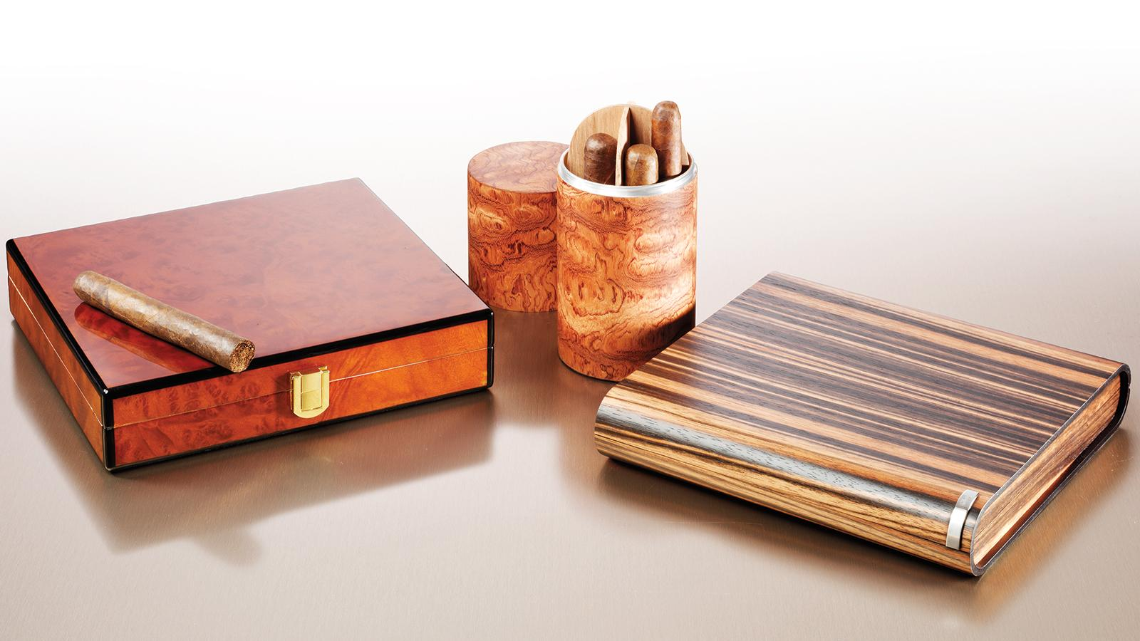 From left: Daniel Marshall Desktop/Travel Humidor ($250), Brizard & Co. Cylinder Desk Humidor ($199) and Davidoff of Geneva's Voyager humidor ($1,290).