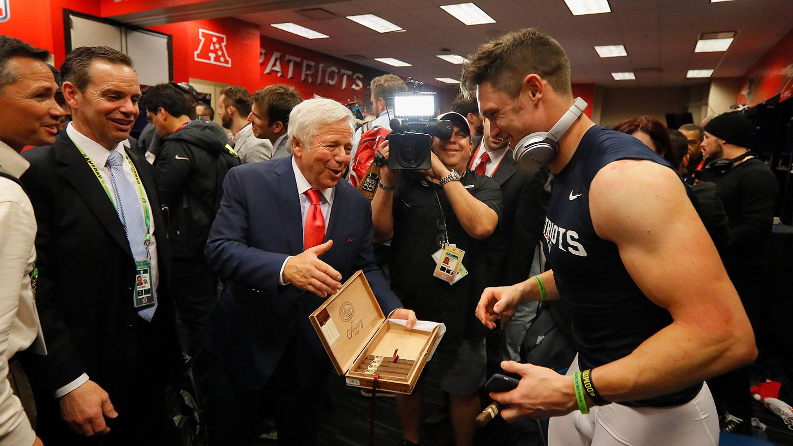 Patriots' owner Robert Kraft offers receiver Chris Hogan a celebratory Padrón cigar after winning Super Bowl LI.