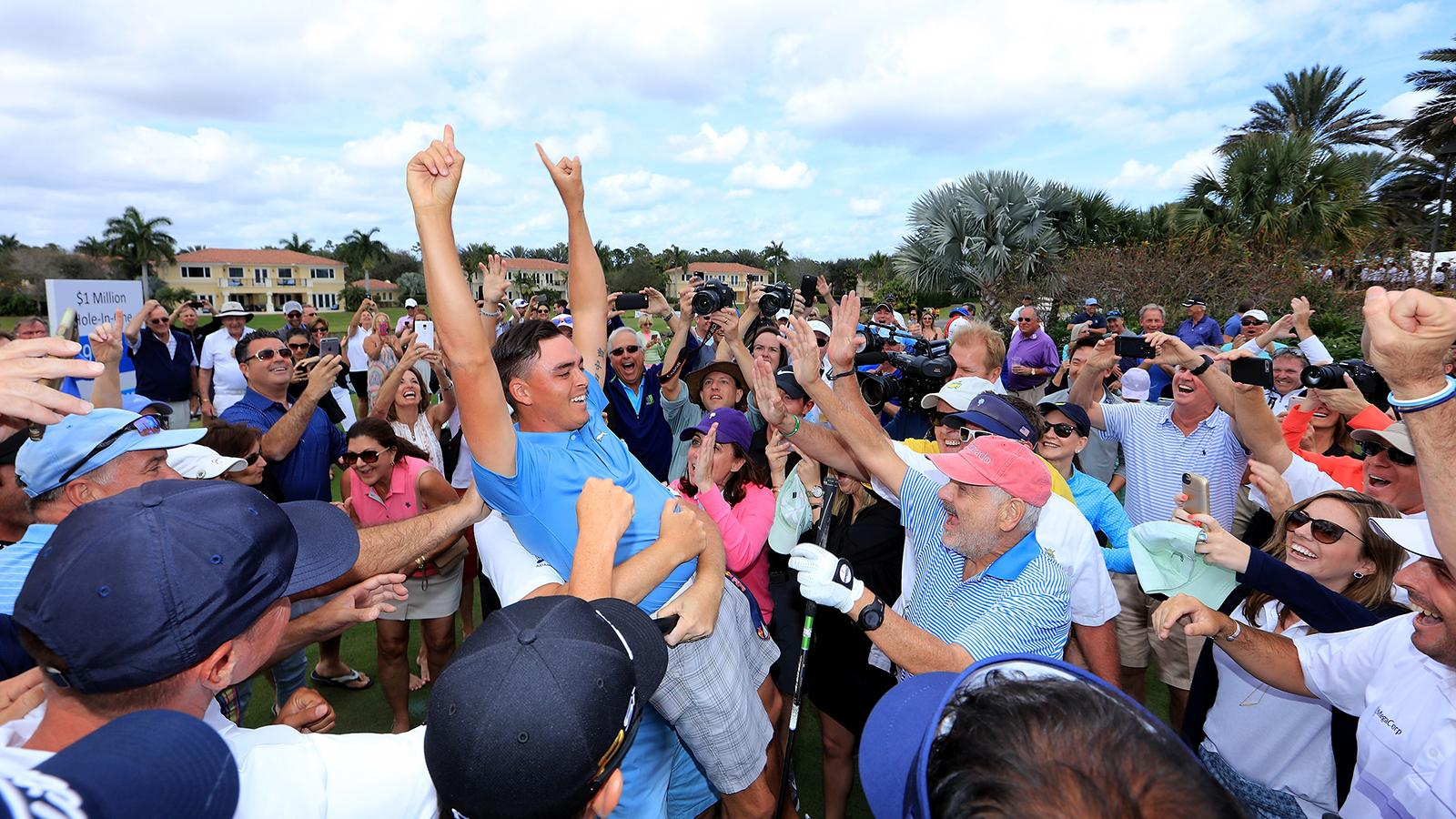 The crowd went crazy when Rickie Fowler hit a hole-in-one at the Els for Autism Pro-Am, raising $1 million with one swing.