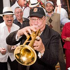 Arturo Sandoval puts on a show at the Fuente booth.