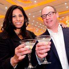 Geena and Scott Cooper enjoying a Crystal Head vodka martini at Cigar Aficionado's Big Smoke.