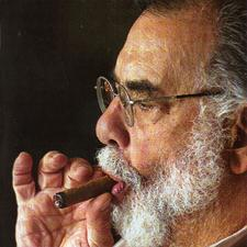 Portrait of francis ford coppola smoking a cigar.