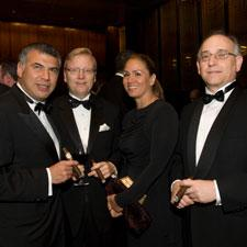 Alejandro Turrent, left, and his wife, Emma, with Javier Estades and Fernando Dominquez of Altadis.