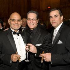 Cigarmakers Ernesto Perez-Carrillo, left, with Alan Rubin, center, and Ralph Montero of Alec Bradley Cigar Company.