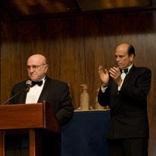 Pier Luigi Tolaini presents a $1 million donation to Michael Milken of the Prostate Cancer Foundation.