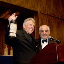 Marvin R. Shanken present Jamie Coulter with his bottle of 1929 Château Haut-Brion.