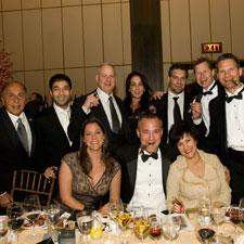 Robert Levin, standing third from left, with from left to right, Manny Ferraro, Sathya Levin, Janny Garcia, Pete Johnson, Dan Murphy, Sean Knutsen and Cynthia Fuente, seated.