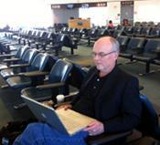 Gordon Mott waiting for a plane to Cuba.