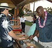 Tai Erum of the Kauai Cigar Company handed out cigars.