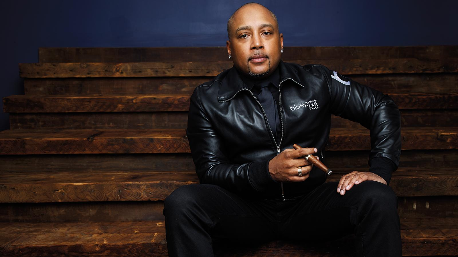 Daymond John smoking a cigarette (or weed)
