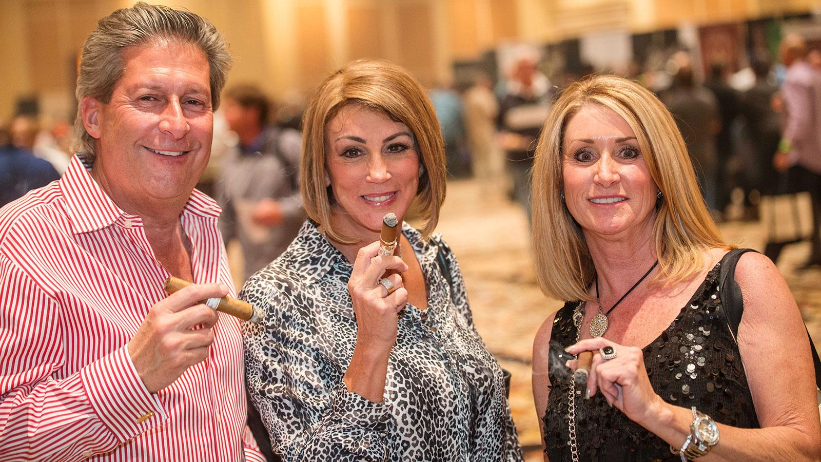 Richard Karle, Tina Young and Michelle Pace enjoy a few fine cigars at the Big Smoke Evening.