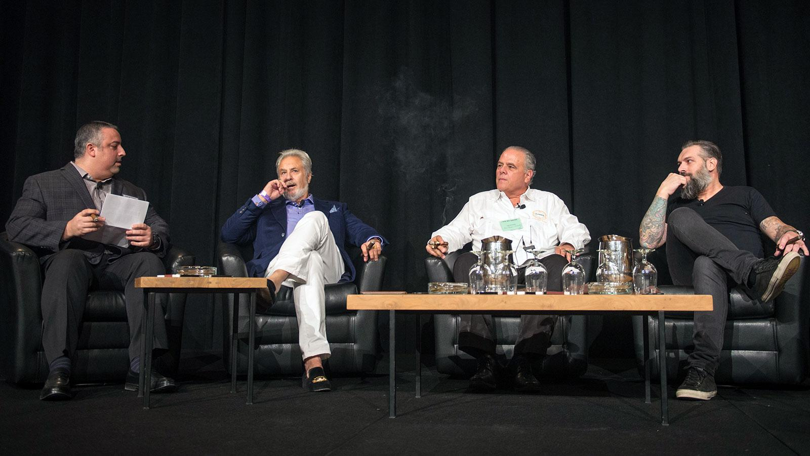 Senior editor Gregory Mottola, far left, speaks with three cigarmakers for a seminar on Miami-made cigars. From left: Bill Paley, of La Palina, Paul Palmer, of Casa Fernandez, and Pete Johnson, of Tatuaje.