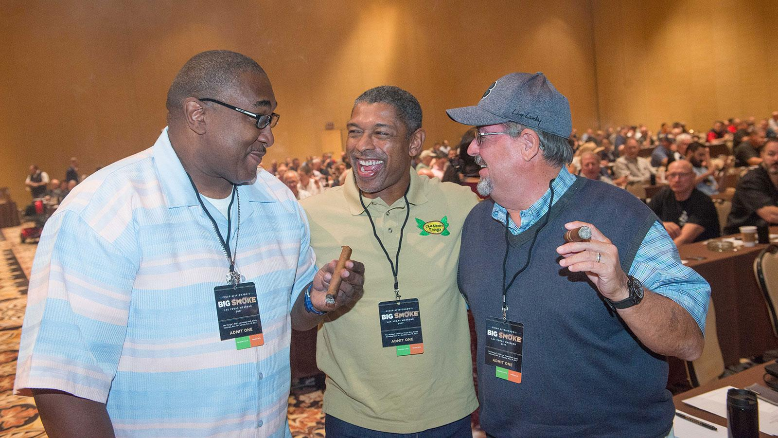 Walter Frazier, Ted Hughes and David Boggs share a laugh in between seminars.