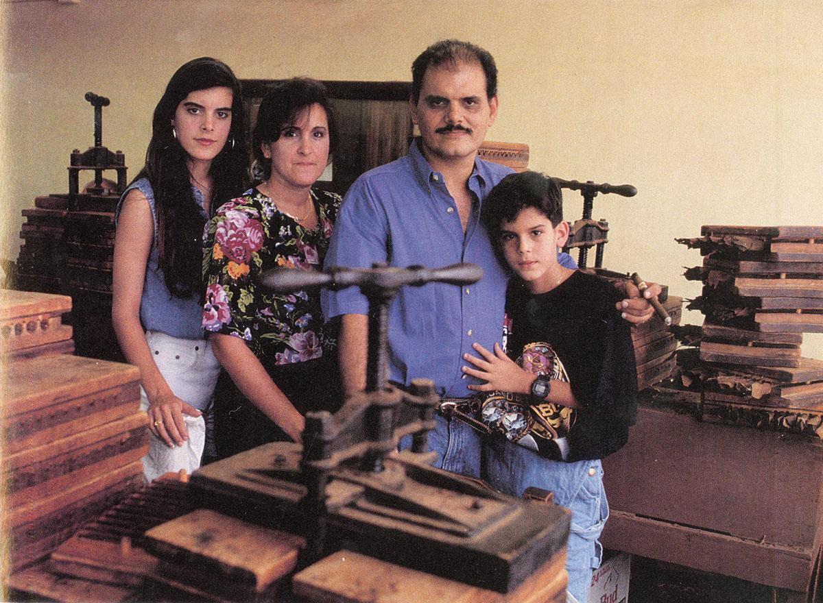 Ernesto Perez-Carrillo, surrounded by his family in his Little Havana cigar factory in 1992.