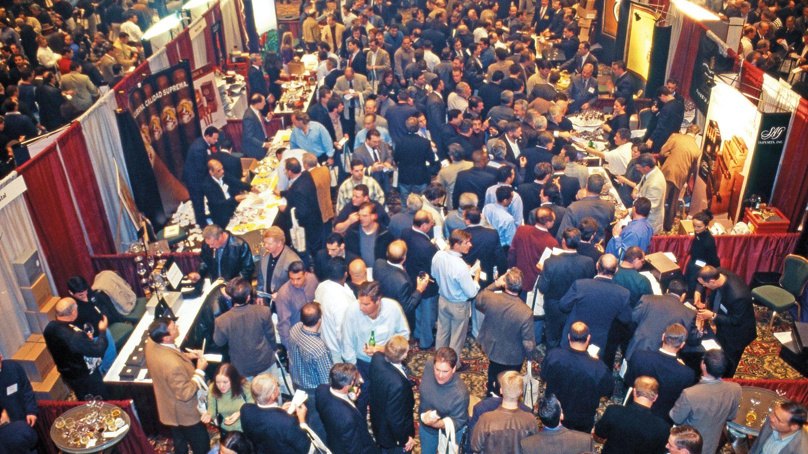 Cigar consumers eagerly sampling the wide array of cigars at a Cigar Aficionado Big Smoke in 2000.