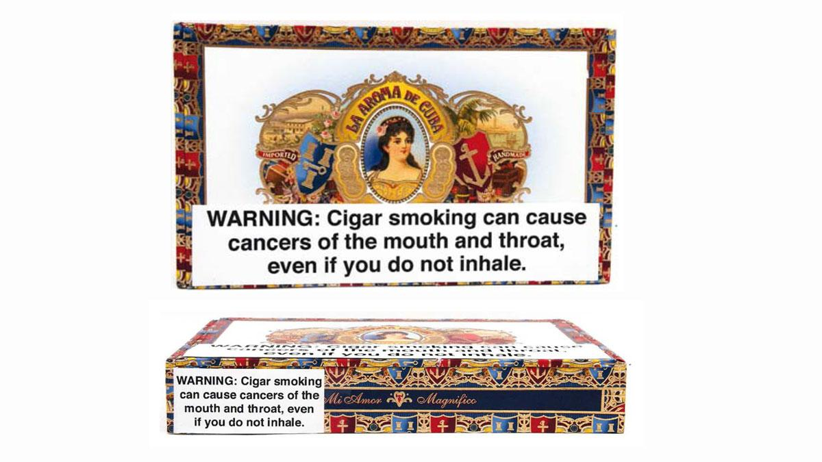 Cigar box images included in the lawsuit depict the sheer size and stark format of the warning labels.