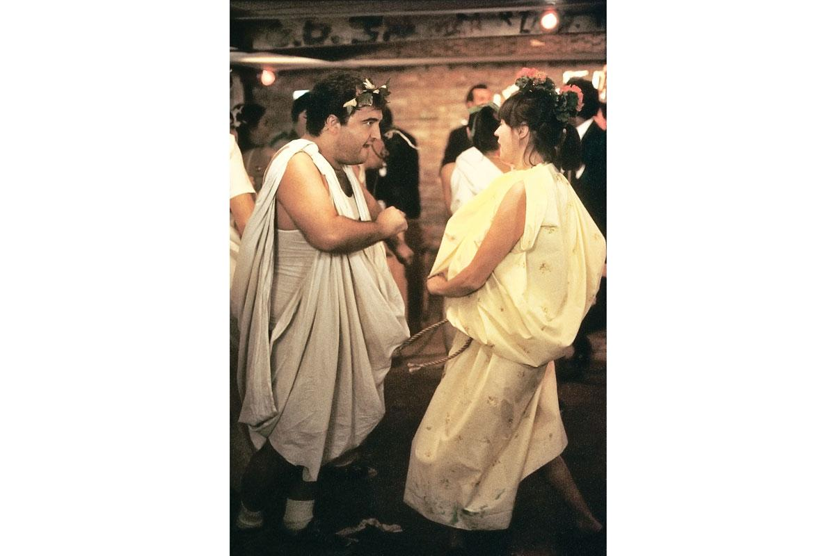 How do you react to a threat from the rulers of the college? Throw a raucus toga party.