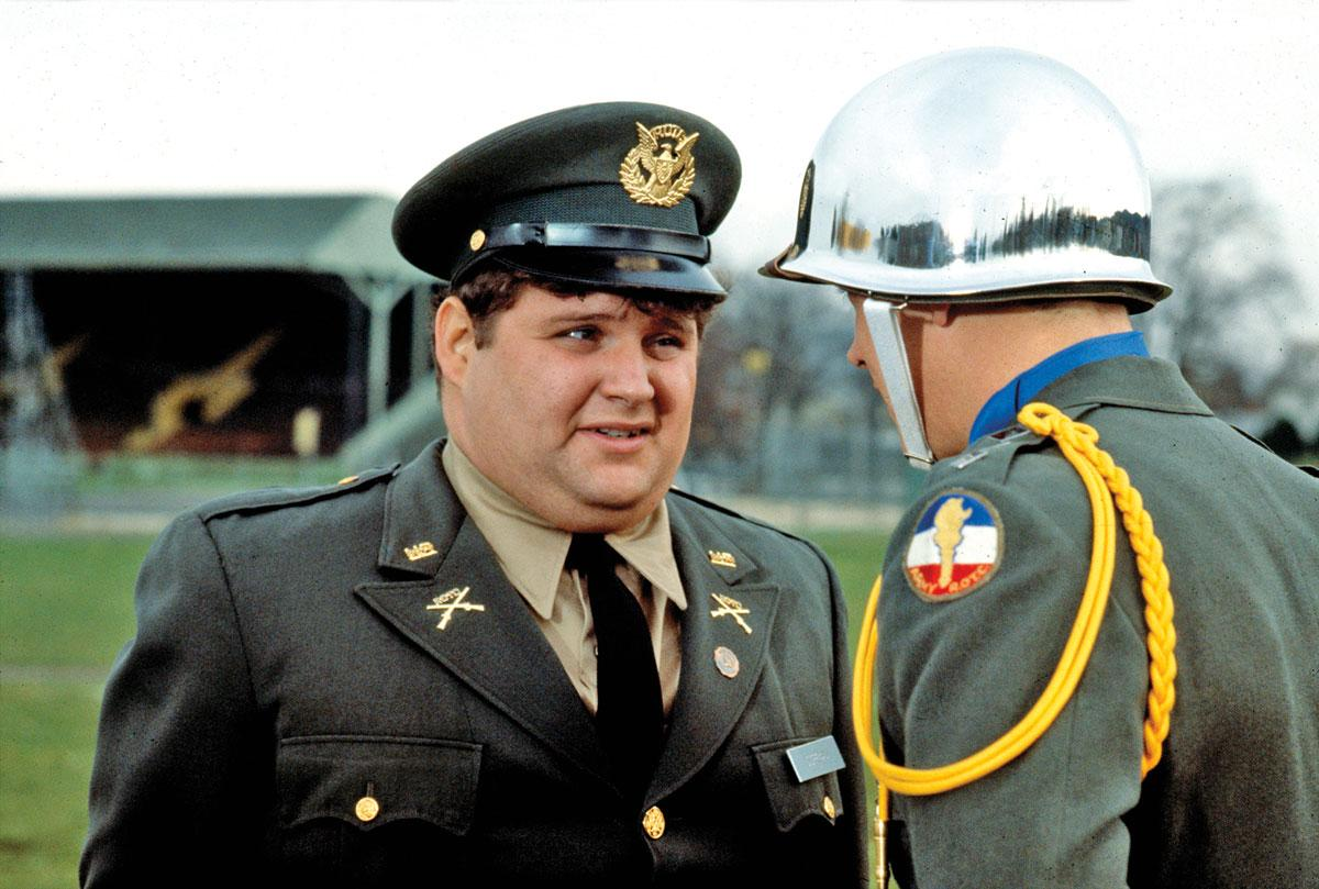 Stephen Furst (left) played the eternally harrassed and ever awkward Flounder, seen here taking a spit-laden tongue lashing from Mark Metcalf's aggressive character Douglas A. Neidermeyer.