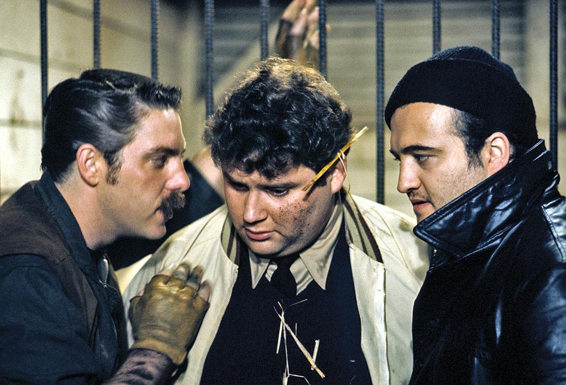 D-Day and Bluto trying their best to convince Flounder to shoot the Dean's horse.
