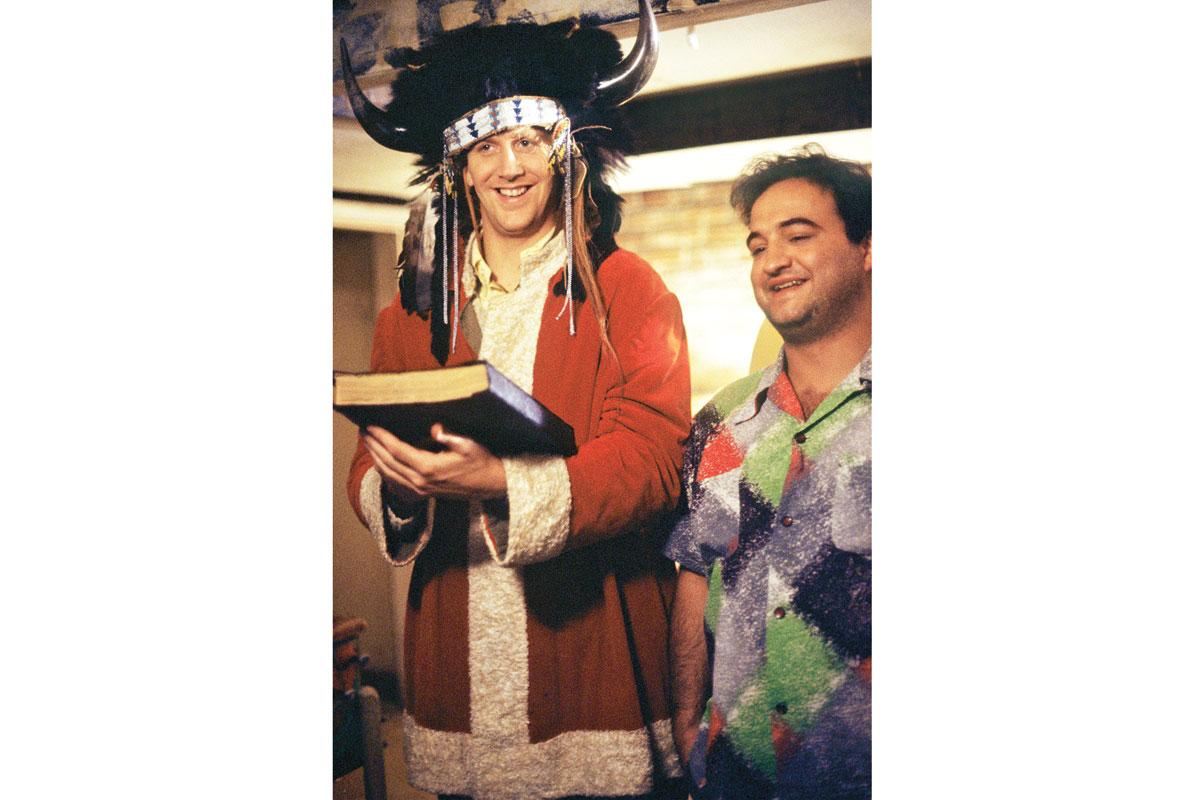 Widdoes (as Hoover) and Belushi (as Bluto) swear in new pledges in Delta style.