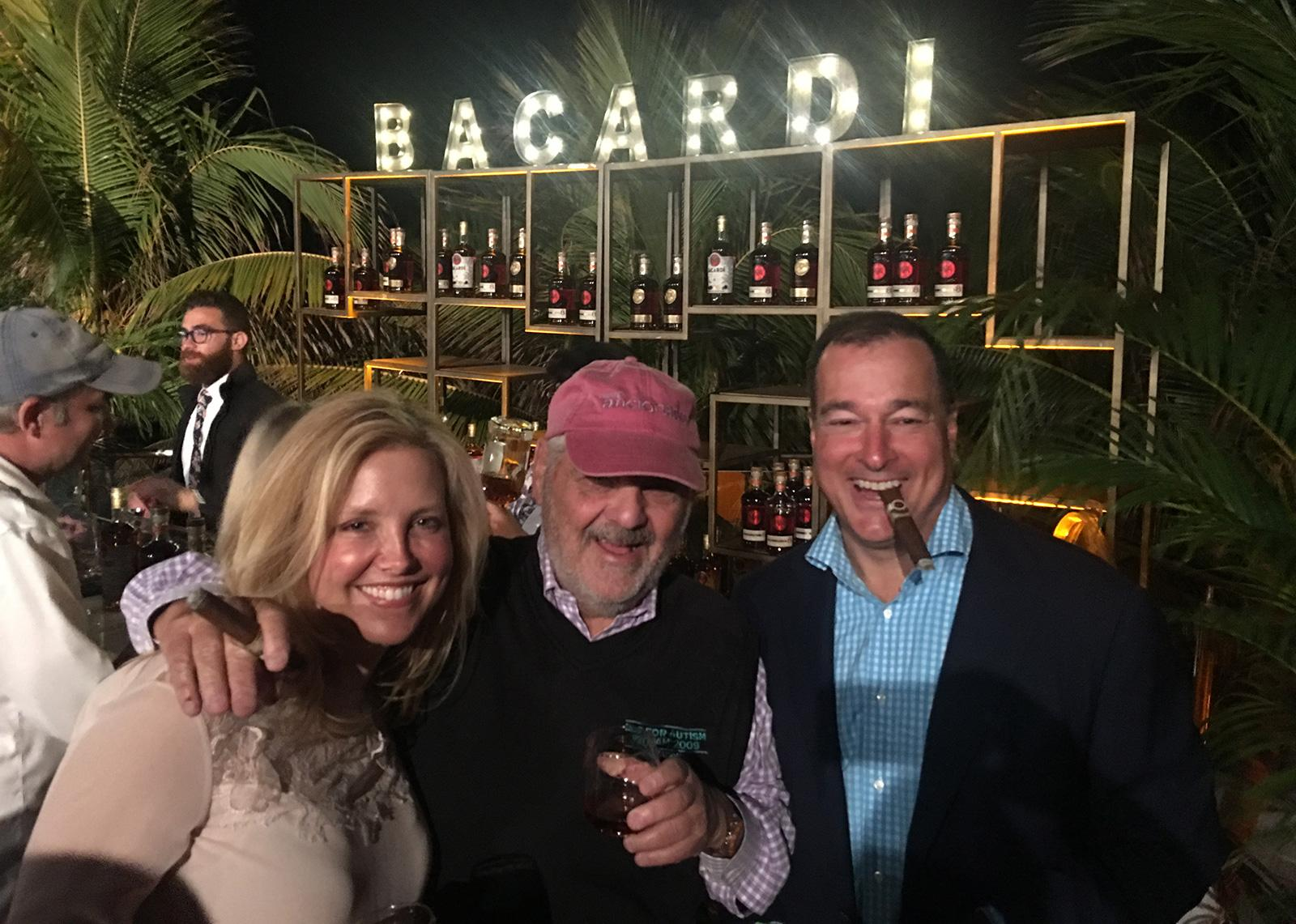 Cigar Aficionado editor and publisher Marvin R. Shanken, center, enjoys a cigar with Elizabeth and Facundo Bacardi.