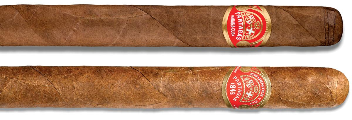 A Cuban Partagás next to one of the non-Cuban versions, which is rolled in the Dominican Republic.