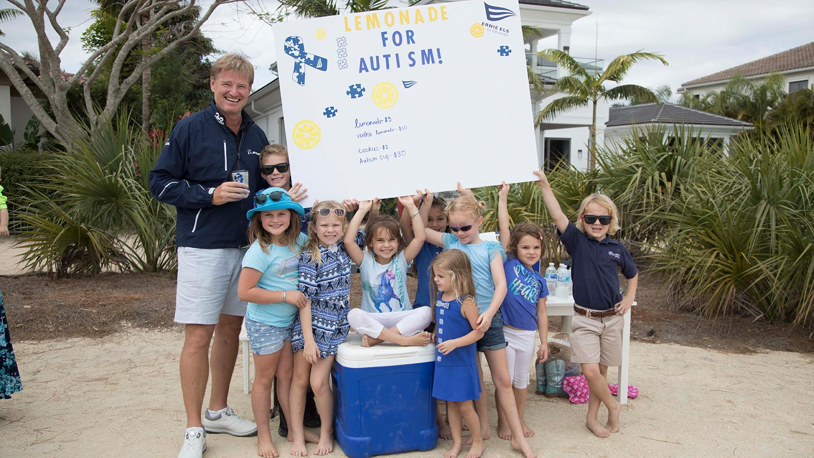 Ernie Els visits an old-fashioned lemonade stand set up by children at the Pro-Am.