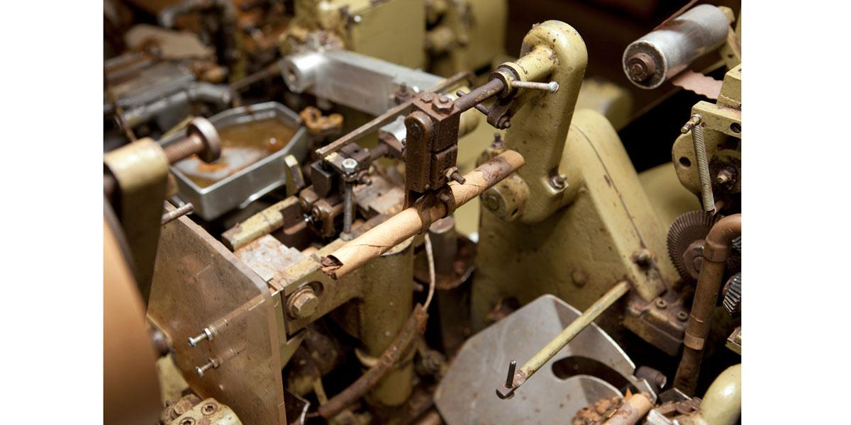 Cigars are made by machine, using a method that takes a considerable human touch to ensure that the decades-old devices operate properly.