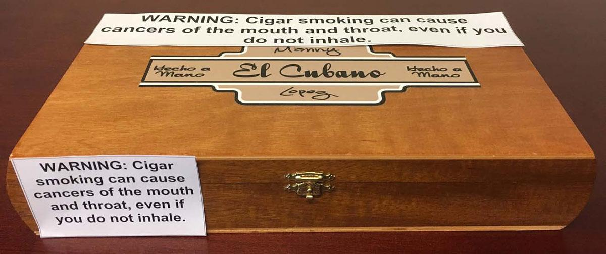 A mockup of an El Cubano cigar box depicting how the new FDA warning labels would appear.