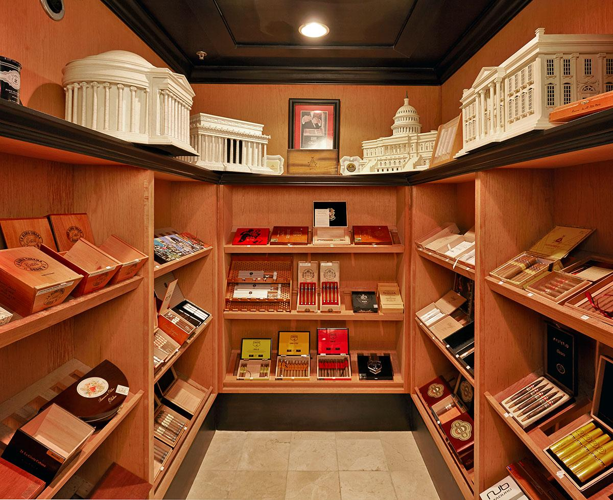 The walk-in humidor is custom made with Spanish cedar shelving and doors from an old estate in Asheville, North Carolina. Inside is a display collection of Montecristo Historical Series humidors.