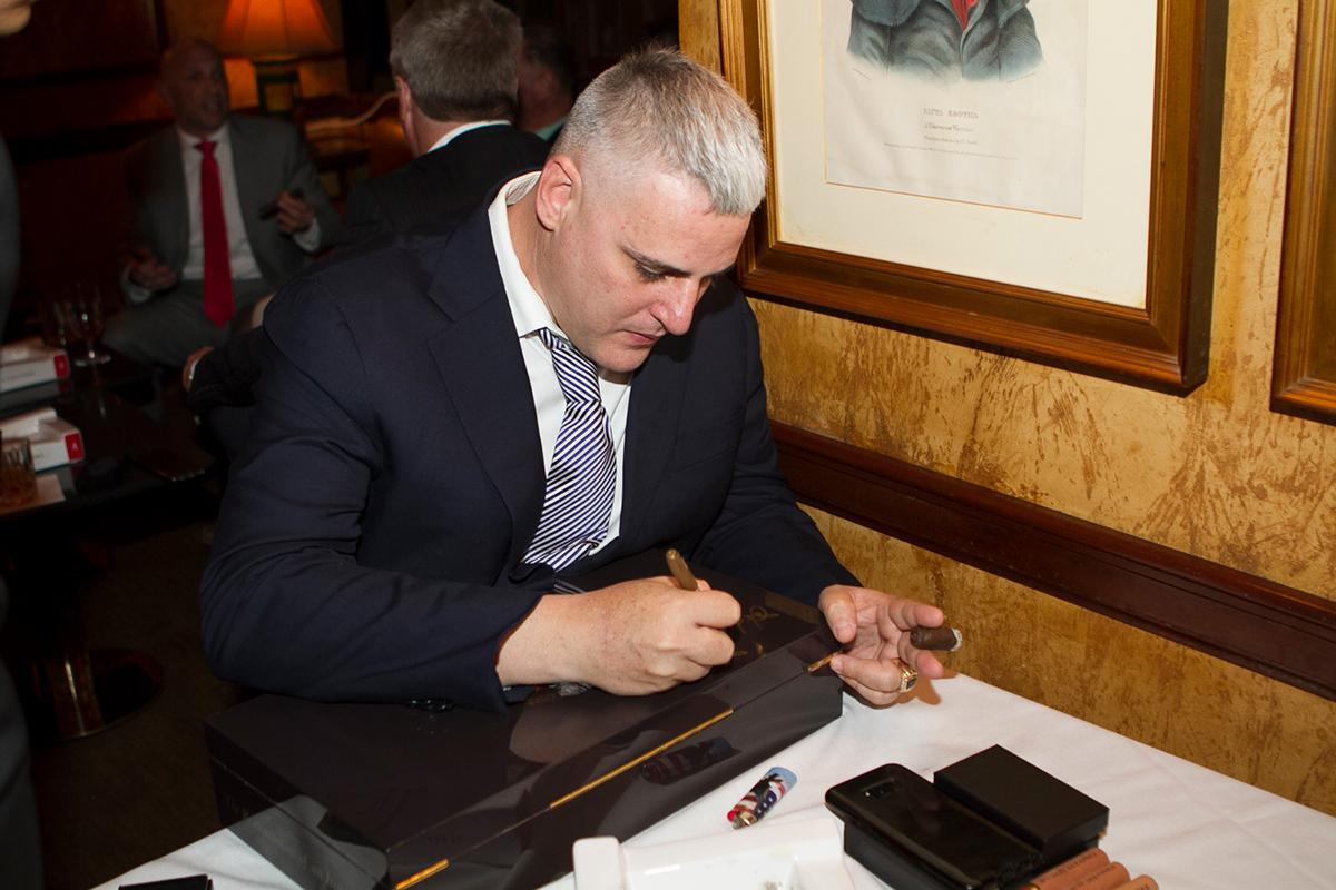 >A humidor filled with cigars was signed by Fernandez and auctioned during a raffle.