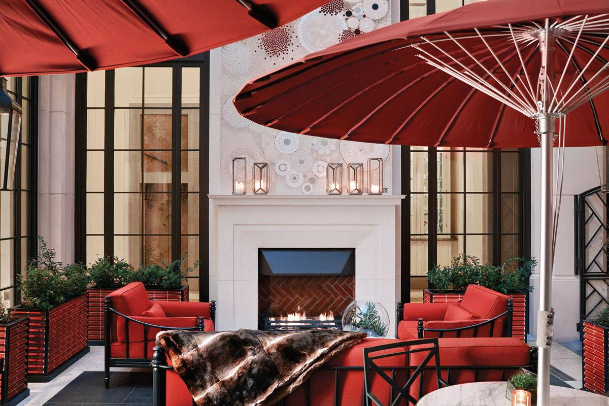 While technically outside, the open-air Corinthia Hotel Garden Lounge is surrounded on all sides by walls. A fireplace provides some of the heat.