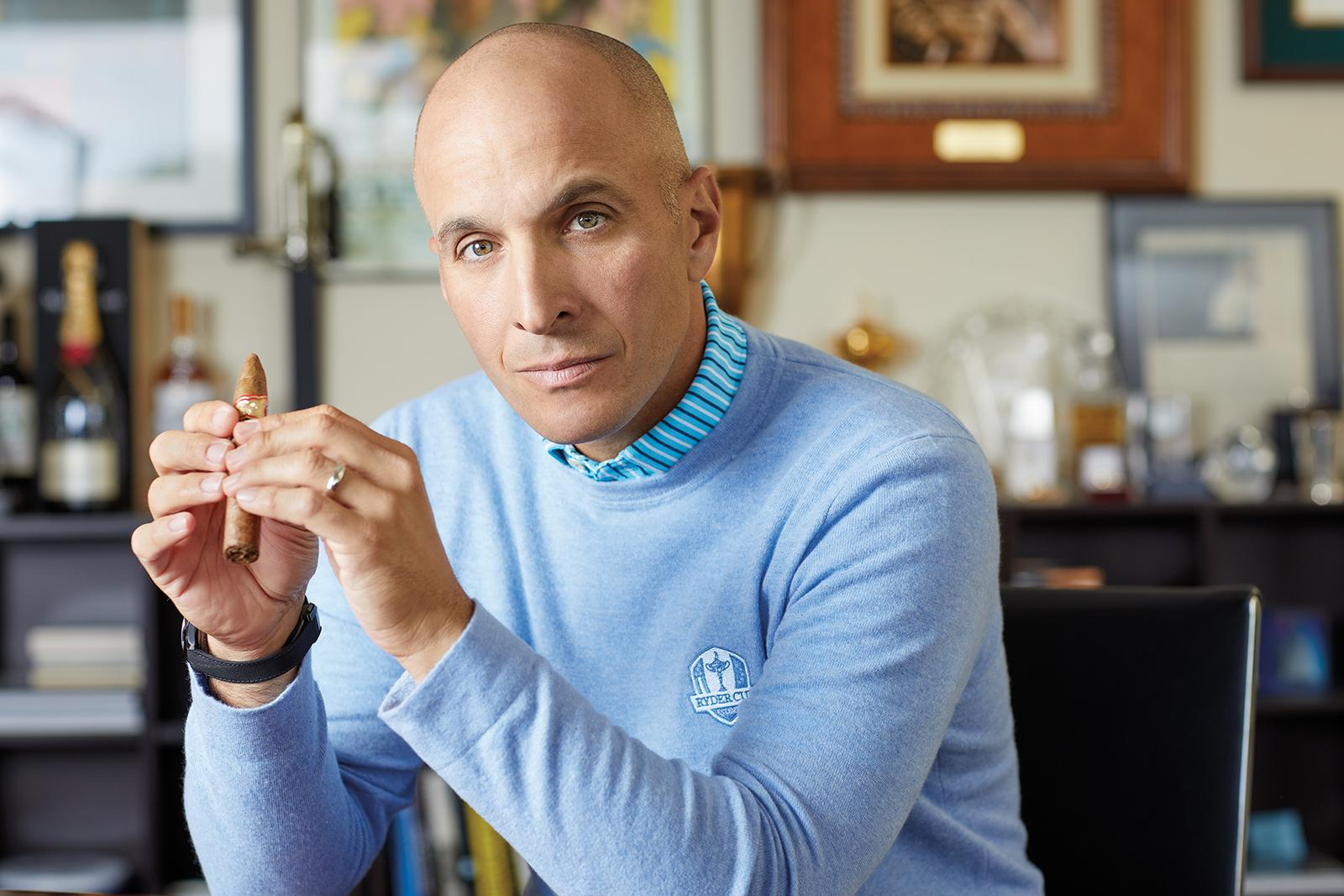 Bevacqua, photographed in his corner office at PGA headquarters, enjoys cigars on the course.