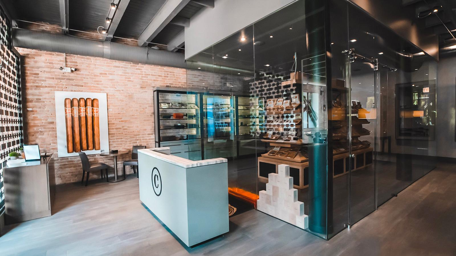 The large, glass-encased humidor occupies the front of the store.