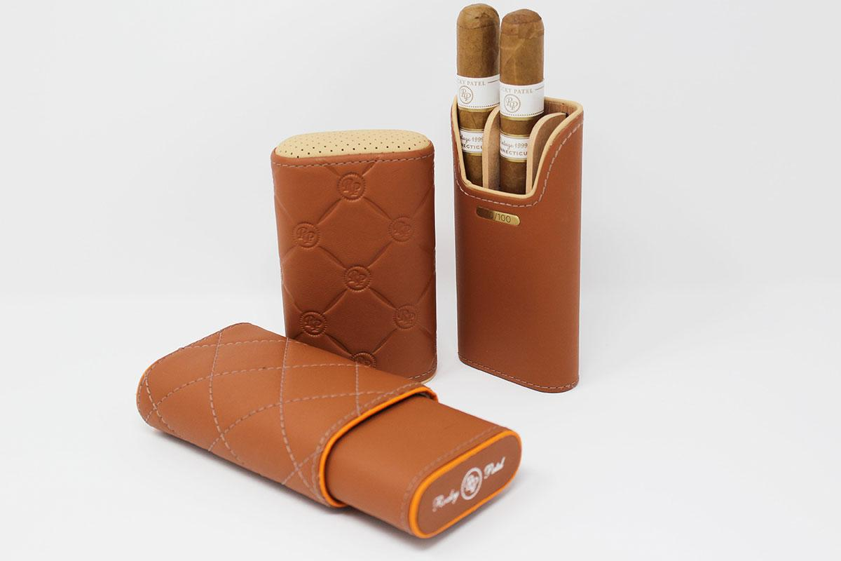 The DBS Collection for Rocky Patel consists of three-finger leather cigar cases inspired by the interior of an Aston Martin.