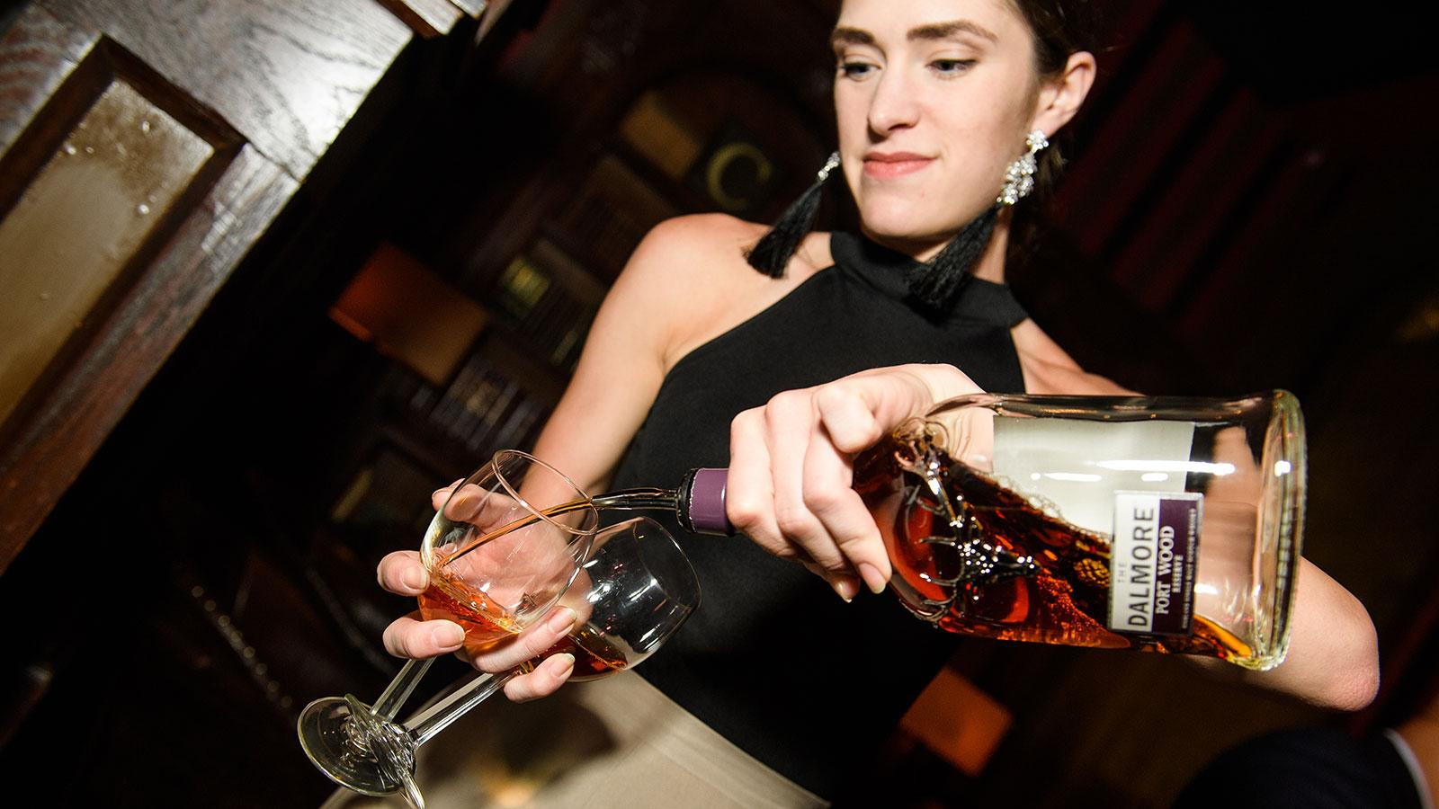 A representative from The Dalmore Scotch pours the Port Wood Reserve.