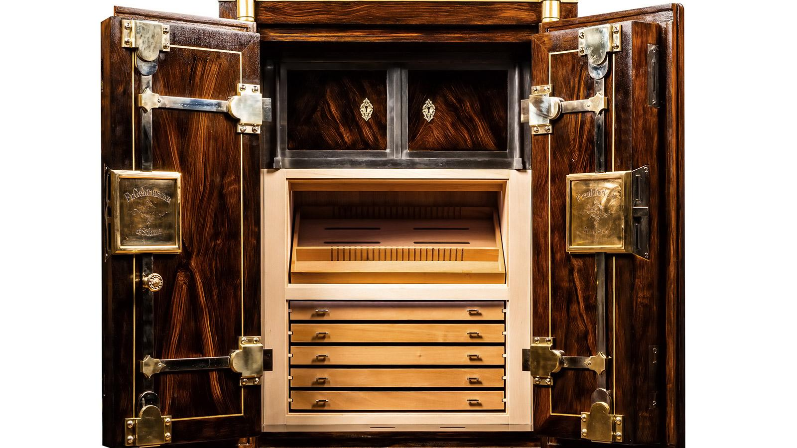 The cedar-lined cabinet, which consists of five drawers and one tray, holds up to 1,000 cigars.