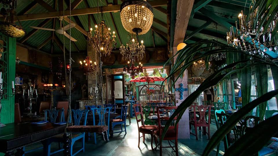 The interior décor of Cape to Cuba, an eclectic mix of colorful artifacts, creates a captivating roadside attraction.