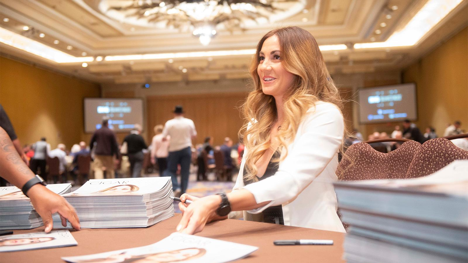Micallef partner Delicia Silva was on hand to sign calendars.