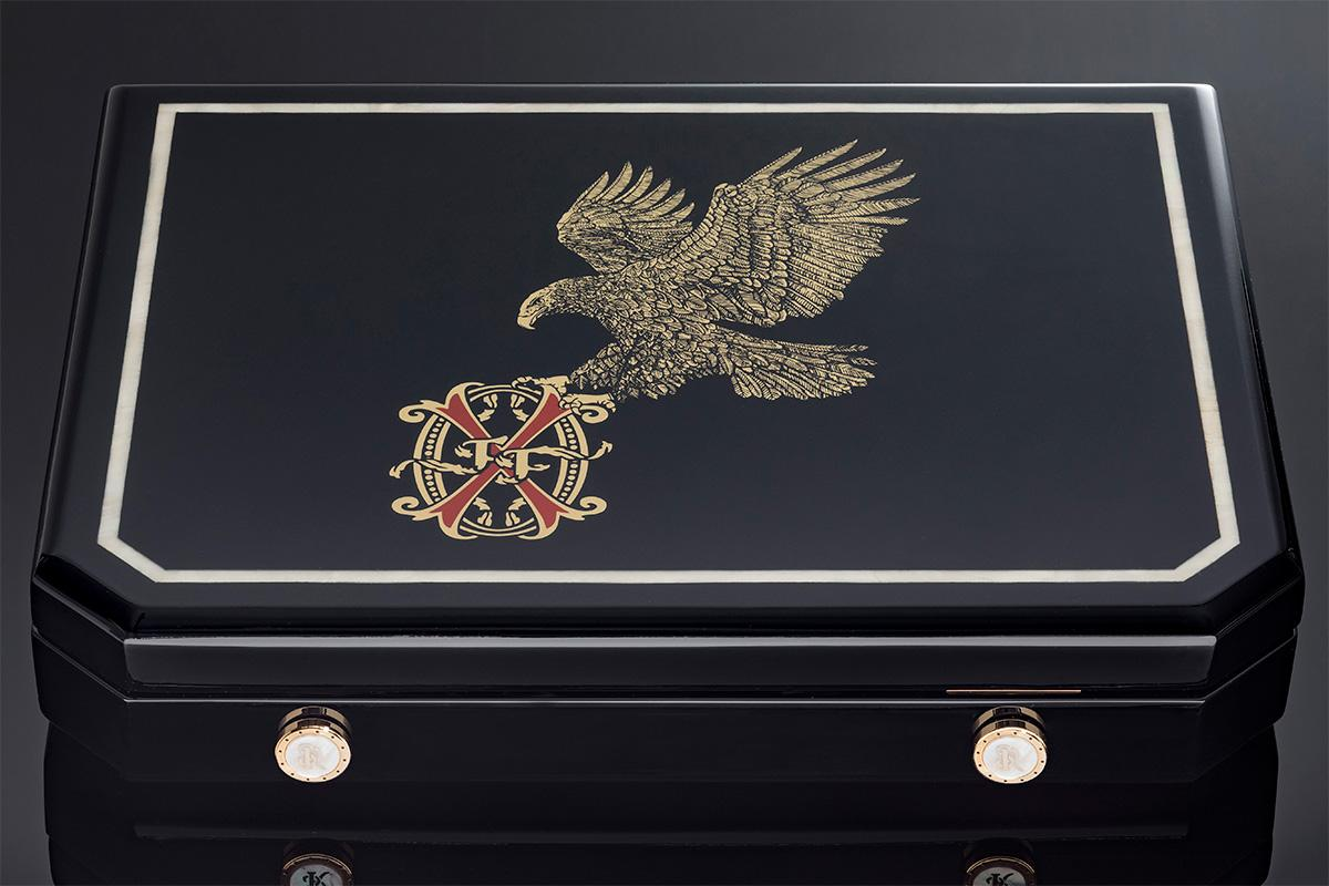 The exterior of the OpusX by Stefano Ricci travel humidor features an Australian Mother of Pearl inlay and black lacquered finish.