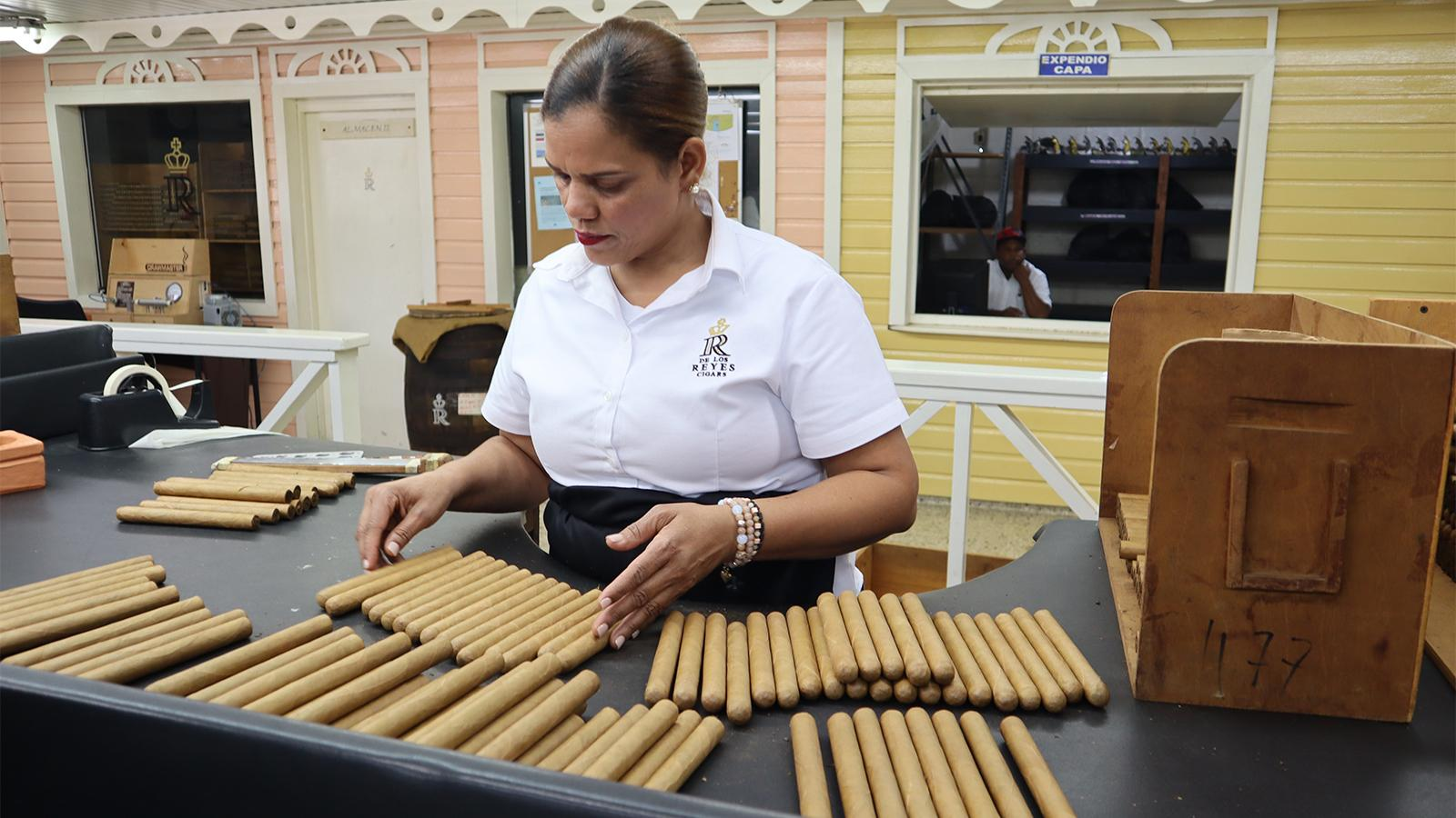 A cigar sorting table inside De Los Reyes Cigar Factory.