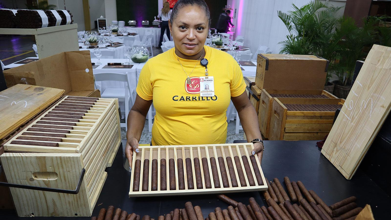 Factory worker inside EPC Cigar Co.'s La Alianza factory checks color consistency.
