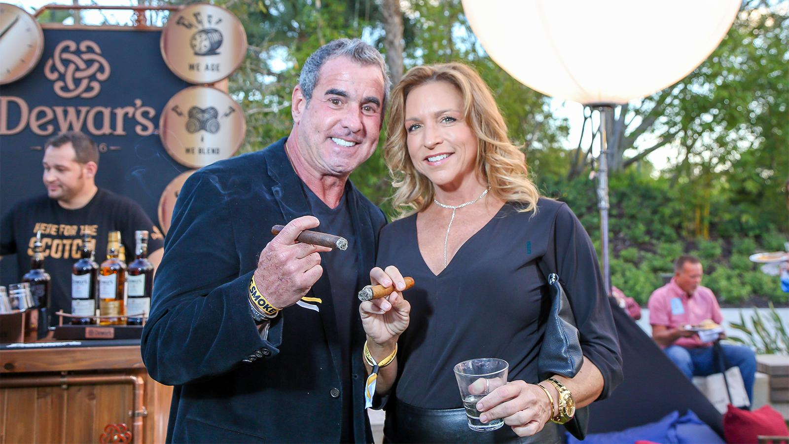 Shannon Quigley and Michael Marin enjoy a cigar with their drinks during the event.