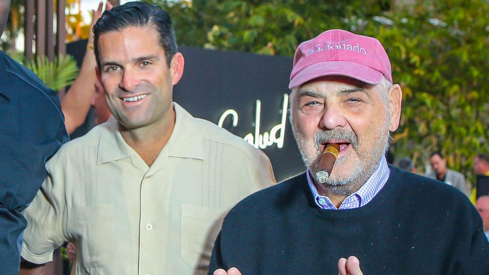 University of Miami football head coach Manny Diaz with Marvin R. Shanken, editor and publisher of Cigar Aficionado.