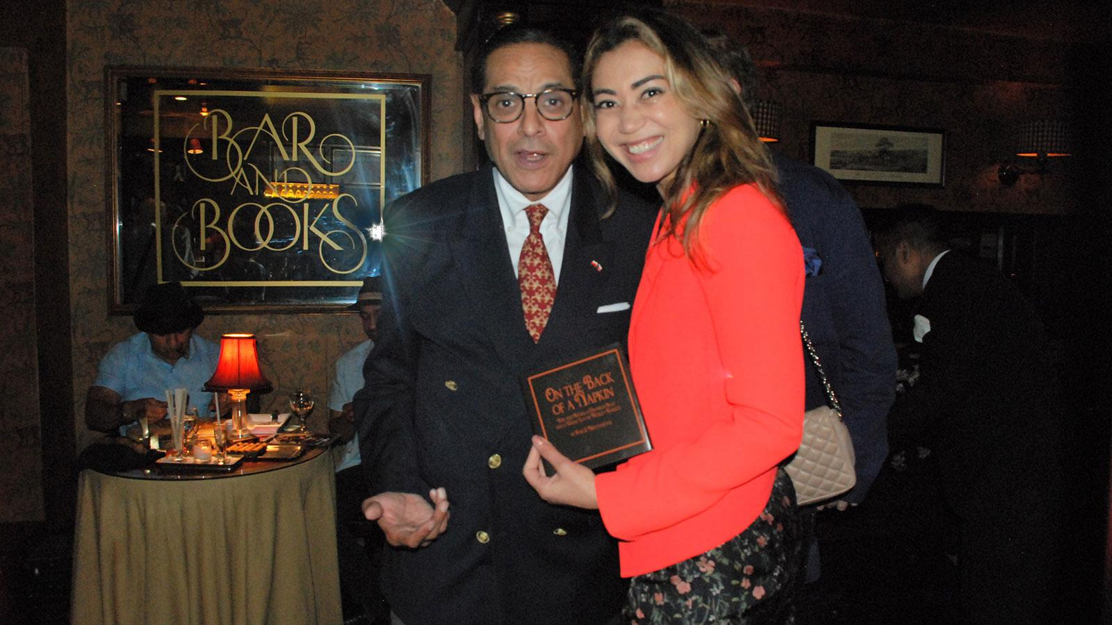 Bar and Books owner Raju S. Mirchandani with guest Elena Cavalcante.