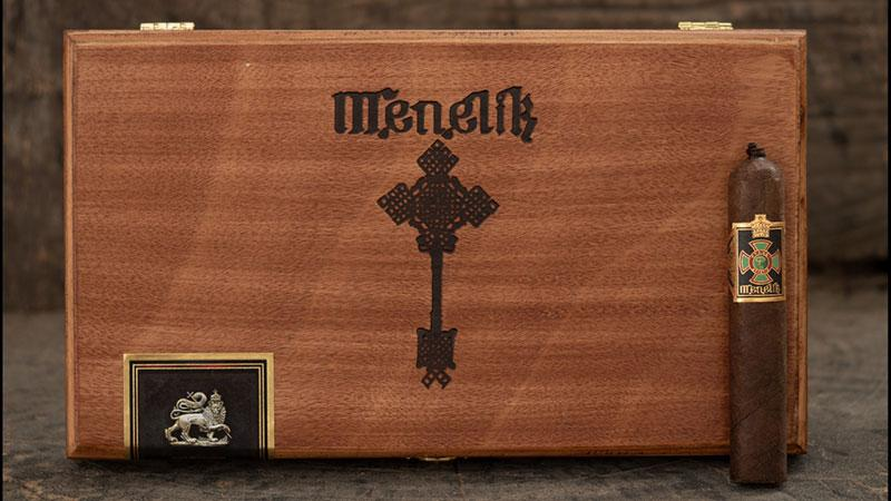 Menelik is a soft-pressed petit robusto with a pigtail that measures 4 1/2 inches by 52 ring gauge.