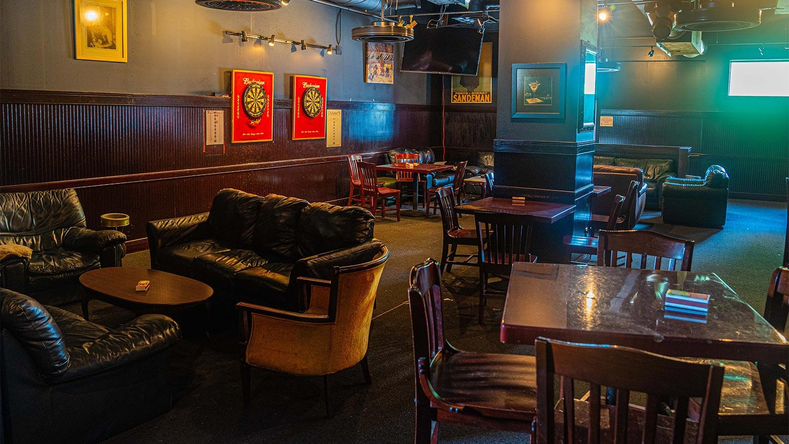 Havana Deluxe is dark, even at midday, with a classic neighborhood pub-meets-basement recreation room vibe