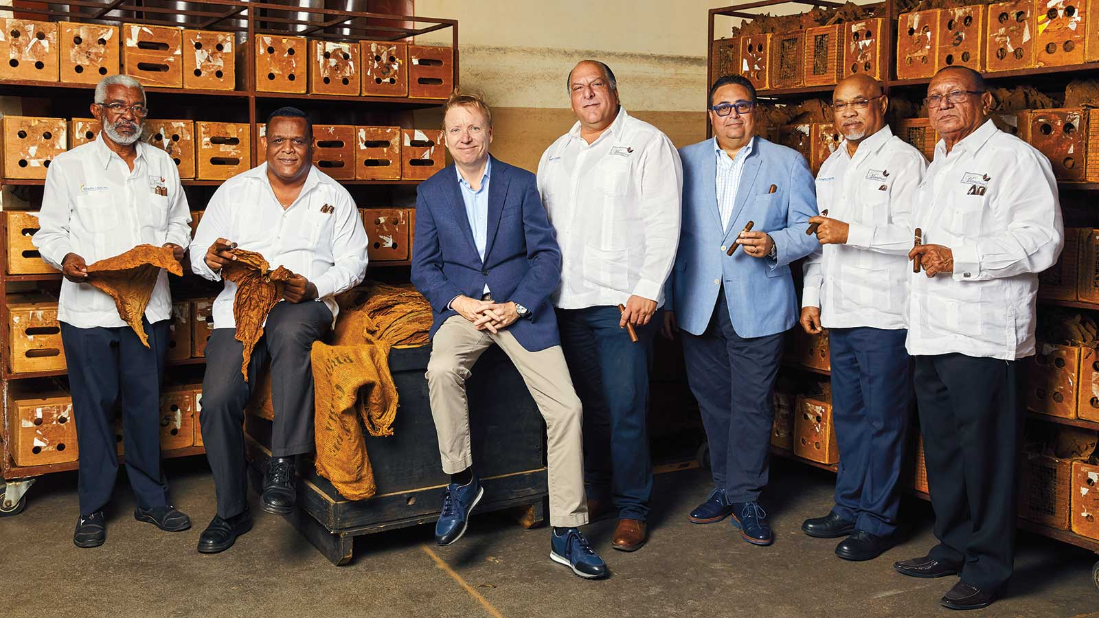 These stewards of Tabacalera de Garcia ensure quality and consistency for the brands of Altadis. They stand in front of blend boxes on the factory floor. From left to right: Nestor Rodriguez, Pedro Ventura, Javier Estades, Javier Elmudesi, Rafael Nodal, Carlos Travieso and Victor Avila.