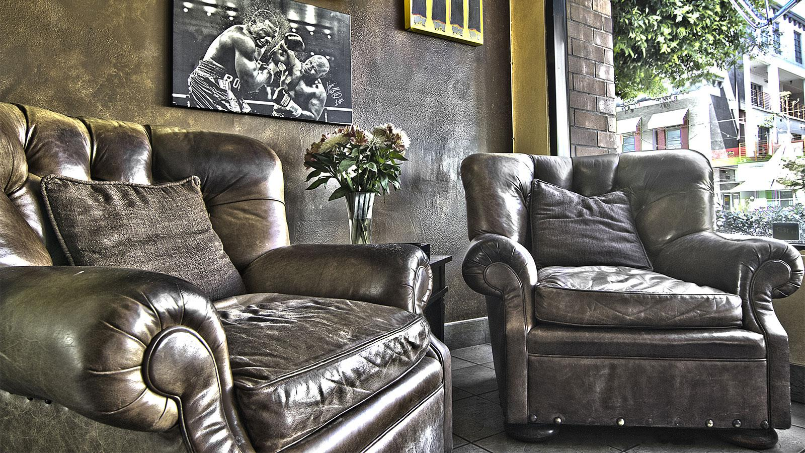 Though the space is small, Hollywood Smoke offers comfortable leather chairs for visitors to relax on while they enjoy their cigar.